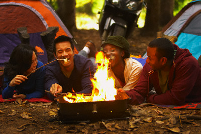 Couples Camping and Roasting Marshmallows
