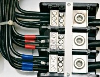 1268361-close-up-shot-of-an-electrical-panel-wiring-with-color-coded-cables-357x276.jpg